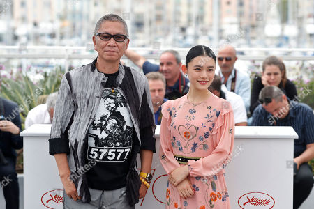 Takashi Miike, Hanna Sugisaki Director Takashi Miike, left, and actress Hanna Sugisaki pose for photographers during the photo call for the film Blade of the Immortal at the 70th international film festival, Cannes, southern France