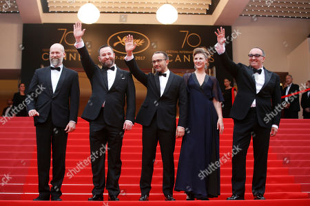 From right, producer Alexander Rodnyansky, actress Maryana Spikav, director Andrey Zvyagintsev and actor Alexei Rozin pose for photographers upon arrival at the screening of the film Loveless at the 70th international film festival, Cannes, southern France