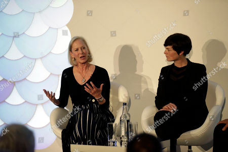 American businesswoman and philanthropist Wendy Schmidt, left, speaks on stage next to long-distance British yachtswoman Ellen MacArthur at the launch of the New Plastics Economy Innovation Prize at the Saatchi Gallery in London, . The Ellen MacArthur Foundation, in collaboration with the Prince's International Sustainability Unit announced the launch of the $2 million New Plastics Economy Innovation Prize on Thursday, which aims to come up with new ways to design packaging to help keep plastics out of the ocean
