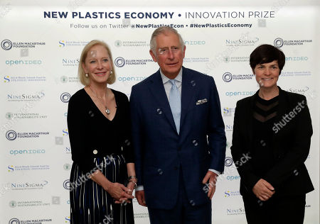 Britain's Prince Charles poses for photographs with long-distance British yachtswoman Ellen MacArthur, right, and American businesswoman and philanthropist Wendy Schmidt as he arrives for the launch of the New Plastics Economy Innovation Prize at the Saatchi Gallery in London, . The Ellen MacArthur Foundation, in collaboration with the Prince's International Sustainability Unit announced the launch of the $2 million New Plastics Economy Innovation Prize on Thursday, which aims to come up with new ways to design packaging to help keep plastics out of the ocean