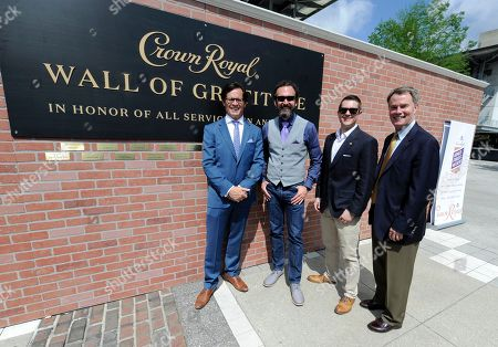Stock Photo of Indianapolis Motor Speedway President Doug Boles, from left, Crown Royal National Brand Ambassador Stephen Wilson, Crown Royal Director Jim Ruane and Indianapolis Mayor Joe Hogsett pose in front of the Crown Royal Wall of Gratitude, at the Indianapolis Motor Speedway