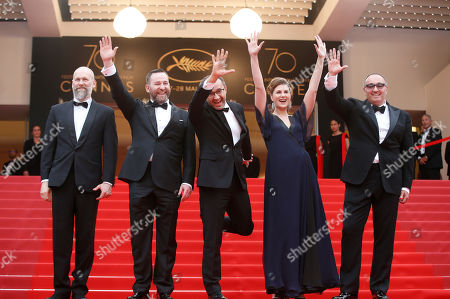 Alexander Rodnyansky, Maryana Spikav, Andrey Zvyagintsev, Alexei Rozin From right, producer Alexander Rodnyansky, actress Maryana Spikav, director Andrey Zvyagintsev and actor Alexei Rozin pose for photographers upon arrival at the screening of the film Loveless at the 70th international film festival, Cannes, southern France