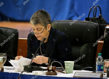 University of California President Janet Napolitano reads through papers during the public comment period of the Board of Regents meeting, in San Francisco. California's state auditor briefed the governing board Thursday on findings that UC administrators hid $175 million in a secret reserve fund even as the system raised tuition and sought more public funding. Howle says her office found murky budgeting practices in the office of UC President Janet Napolitano that failed to track expenditures and explain decision-making