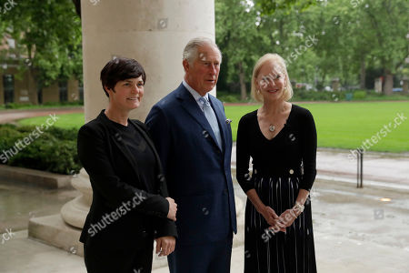 Britain's Prince Charles poses for photographs with long-distance British yachtswoman Ellen MacArthur, left, and American businesswoman and philanthropist Wendy Schmidt as he arrives for the launch of the New Plastics Economy Innovation Prize at the Saatchi Gallery in London, . The Ellen MacArthur Foundation, in collaboration with the Prince's International Sustainability Unit announced the launch of the $2 million New Plastics Economy Innovation Prize on Thursday, which aims to come up with new ways to design packaging to help keep plastics out of the ocean