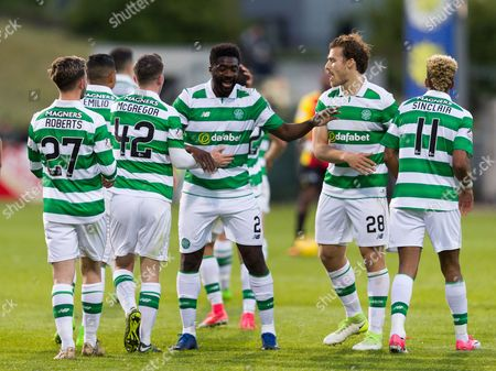 Kolo Toure of Celtic joins i n the celebrattions after Callum McGregor scored their 4th goal during the SPFL Ladbrokes Premiership match between Partick Thistle & Celtic at Firhill, Glasgow on 18th May.