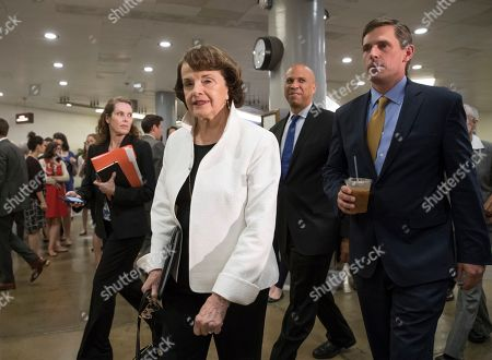 Dianne Feinstein, Cory A. Booker, Martin Heinrich From left, Senator Dianne Feinstein, D-Calif., ranking member on the Senate Judiciary Committee, Senator Cory A. Booker, D-N.J., and Senator Martin Heinrich, D-N.M., walk on Capitol Hill in Washington, to meet with Deputy Attorney General Rod Rosenstein for a briefing of the full Senate amid controversy over President Donald Trump's firing of FBI Director James Comey