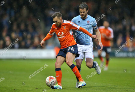 Andy Taylor of Blackpool  and Lawson D'Ath of Luton Town   during the Sky Bet League Two Play-off semi-final second leg match between Luton Town and Blackpool    played at Kenilworth  Road   ,Luton  on 18th May  2017