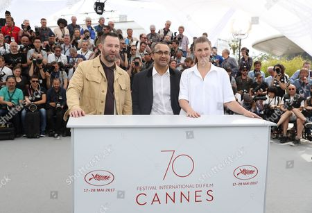 Alexei Rozin, Andrey Zvyagintsev, Maryana Spikav From left, actor Alexei Rozin, director Andrey Zvyagintsev and actress Maryana Spikav pose for photographers during the photo call for the film Loveless at the 70th international film festival, Cannes, southern France