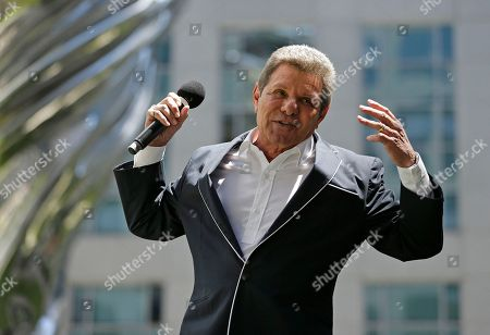 Frankie Avalon performs below a 92-foot stainless steel Venus sculpture during the opening ceremony of the Piazza Angelo, in San Francisco. The sculpture in the piazza at Trinity Place was designed by Lawrence Argent and was a gift to the city from developer Angelo Sangiacomo. The song was Avalon's first number-one hit in 1959