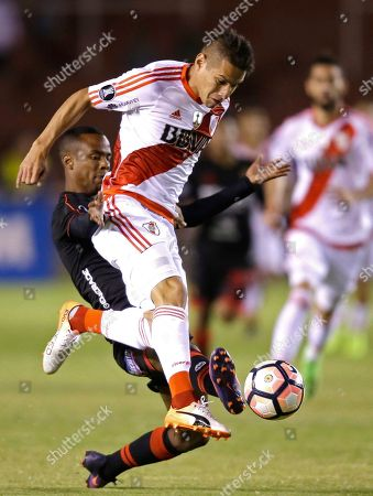 Carlos Auzqui, Nilson Loyola Carlos Auzqui of Argentina's River Plate, front, fights for the ball with Nilton Loyola of Peru's Melgar at a Copa Libertadores soccer match in Arequipa, Peru
