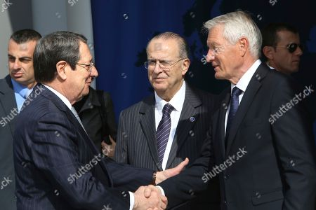 Nicos Anastasiades, Ioannis Kasoulides, Thorbjorn Jagland Cyprus' President Nicos Anastasiades, left, shakes hands with Council of Europe Secretary General Thorbjorn Jagland, right, as Cyprus' Foreign Minister Ioannis Kasoulides watches prior to a session of the Council of Europe's Committee of Ministers at the Filoxenia Conference Center in Nicosia, Cyprus . A new Council of Europe convention will take aim at smugglers and buyers who deal in stolen antiquities and other priceless cultural artifacts in a trade that's often used to finance terrorist organizations