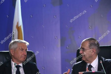 """Thorbjorn Jagland, Ioannis Kasoulides Secretary General of the Council of Europe Thorbjorn Jagland, left, and Cypriot foreign minister Ioannis Kasoulides talk during a press conference after a session of the Committee of Ministers - Council of Europe in Nicosia, Cyprus, on . Jagland told the Associated Press in an interview that new laws enacted by some European countries that impede migrant children from reuniting with their families or force them to leave when they turn 18 create a """"huge security risk"""" by potentially turning youths to crime and terrorism"""