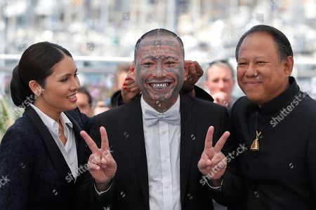Actors Panya Yimumphai, centre, Pornchanok Mabklang, left, and Vithaya Pansringarm pose for photographers during the photo call for the film A Prayer Before Down at the 70th international film festival, Cannes, southern France