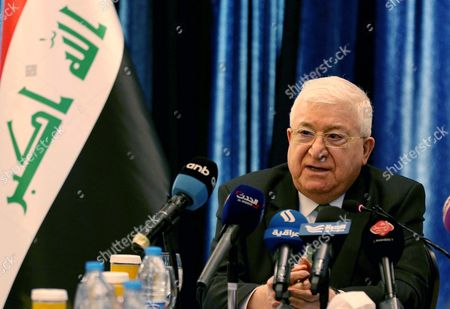 Stock Photo of Iraqi President Fuad Masum (C) speaks during press conference in Amman Jordan on 19 MAY 2017. The Iraqi President is on an official visit to Jordan.