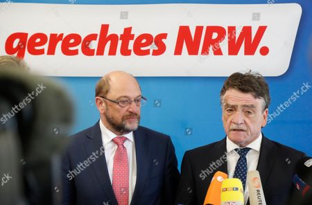 Michael Groschek (R), acting Minister for Transport in North Rhine-Westphalia, speaks next to Martin Schulz, German Chancellor candidate and leader of the Social Democartic Party (SPD) during a press conference after the Executive Committee meeting of the North Rhine-Westphalian Social Democratic Party (SPD) in Duesseldorf, Germany, 19 May 2017. The Executive Committee agreed to propose Groschek as a candidate for new SPD's leader in North Rhine-Westphalia. SPD's election defeat on 14 May 2017 led to the resignation of party leader Hannelore Kraft.