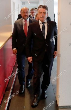 Michael Groschek (R), acting Minister for Transport in North Rhine-Westphalia, walks next to Martin Schulz, German Chancellor candidate and leader of the Social Democartic Party (SPD) to a press conference after the Executive Committee meeting of the North Rhine-Westphalian Social Democratic Party (SPD) in Duesseldorf, Germany, 19 May 2017. The Executive Committee agreed to propose Groschek as a candidate for new SPD's leader in North Rhine-Westphalia. SPD's election defeat on 14 May 2017 led to the resignation of party leader Hannelore Kraft.
