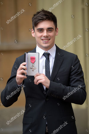 Chris Mears receives an MBE for services to diving at an investiture at Buckingham Palace.