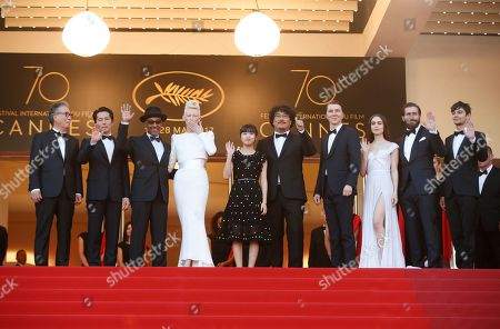 Devon Bostick, Jake Gyllenhaal, Lily Collins, Paul Dano, director Bong Joon-Ho, actors Tilda Swinton, Ahn Seo-Hyun, Steven Yeun, Byung Heebong Actors Devon Bostick, from right, Jake Gyllenhaal, Lily Collins, Paul Dano, director Bong Joon-Ho, actors Tilda Swinton, Ahn Seo-Hyun, Steven Yeun and Byung Heebong, far left, pose for photographers upon arrival at the screening of the film Okja at the 70th international film festival, Cannes, southern France