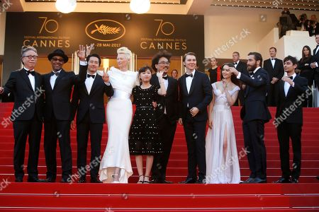 Devon Bostick, Jake Gyllenhaal, Lily Collins, Paul Dano, Bong Joon-Ho, Tilda Swinton, Ahn Seo-Hyun, Steven Yeun, Byung Heebong Actors Devon Bostick, from right, Jake Gyllenhaal, Lily Collins, Paul Dano, director Bong Joon-Ho, actors Tilda Swinton, Ahn Seo-Hyun, Steven Yeun and Byung Heebong, far left, pose for photographers upon arrival at the screening of the film Okja at the 70th international film festival, Cannes, southern France