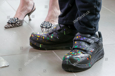 Dale Chihuly, Leslie Jackson The shoes of glass artist Dale Chihuly are spattered with paint as he stands with his wife Leslie Jackson during a ceremony at the Fred & Pamela Buffett Cancer Center in Omaha, Neb., where 10 site-specific art installations by Chihuly at the new cancer center, part of the University of Nebraska Medical Center/Nebraska Medicine, are designed to provide a place of respite and reflection for patients, families and staff dealing with cancer