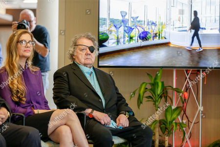Stock Photo of Dale Chihuly, Leslie Jackson Glass artist Dale Chihuly and his wife Leslie Jackson, left, attend a ceremony at the Fred & Pamela Buffett Cancer Center in Omaha, Neb., . Chihuly created 10 site-specific art installations at the new cancer center, designed to provide a place of respite and reflection for patients, families and staff dealing with cancer