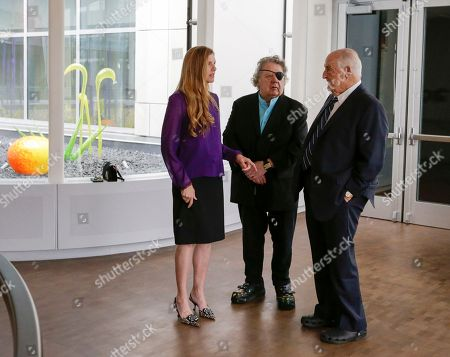 Stock Picture of Walter Scott, Dale Chihuly, Leslie Jackson Glass artist Dale Chihuly, center, and his wife Leslie Jackson, left, chat with philanthropist Walter Scott, right, during a ceremony at the Fred & Pamela Buffett Cancer Center in Omaha, Neb., . A gift by Scott enabled the 10 site-specific art installations by Chihuly at the new cancer center, designed to provide a place of respite and reflection for patients, families and staff dealing with cancer