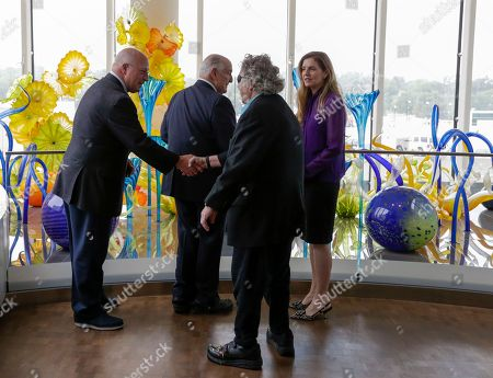 Walter Scott, Dale Chihuly, Leslie Jackson, David Scott Glass artist Dale Chihuly, second right, accompanied by his wife Leslie Jackson, right, shakes the hand of David Scott, left, son of philanthropist Walter Scott, left, following a ceremony at the Fred & Pamela Buffett Cancer Center in Omaha, Neb., . A gift by Walter Scott enabled the 10 site-specific art installations by Chihuly at the new cancer center, designed to provide a place of respite and reflection for patients, families and staff dealing with cancer