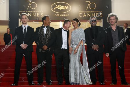 (L-R) Actor Joe Cole, actor Vithaya Pansringarm fFormer Muay-Thai boxer Billy Moore, actress Pornchanok Mabklang, actor Panya Yimumphai and French director Jean-Stephane Sauvaire arrive for the premiere of 'A Prayer Before Dawn' at the 70th annual Cannes Film Festival, in Cannes, France, 19 May 2017. The movie is presented in the Midnight Screening section of the festival which runs from 17 to 28 May.