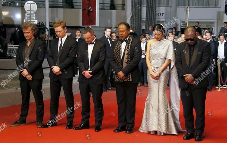 (L-R) French director Jean-Stephane Sauvaire, actor Joe Cole, former Muay-Thai boxer Billy Moore, actor Vithaya Pansringarm, actress Pornchanok Mabklang and actor Panya Yimumphai arrive for the premiere of 'A Prayer Before Dawn' at the 70th annual Cannes Film Festival, in Cannes, France, 19 May 2017. The movie is presented in the Midnight Screening section of the festival which runs from 17 to 28 May.