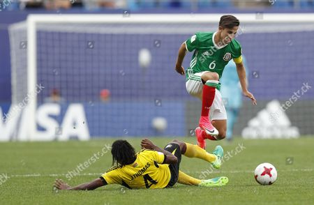 Stock Photo of Alan Cervantes (R) of Mexico vies for the ball with Jason Thomas (L) of Vanuatu during the group stage match of the FIFA U-20 World Cup 2017 between Mexico and Vanuatu in Daejeon, South Korea, 20 May 2017.
