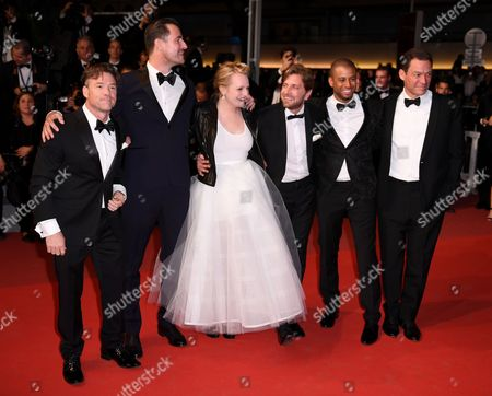 Stock Image of Terry Notary, Claes Bang, Elisabeth Moss, Ruben Ostlund, Christopher Laesso and Dominic West