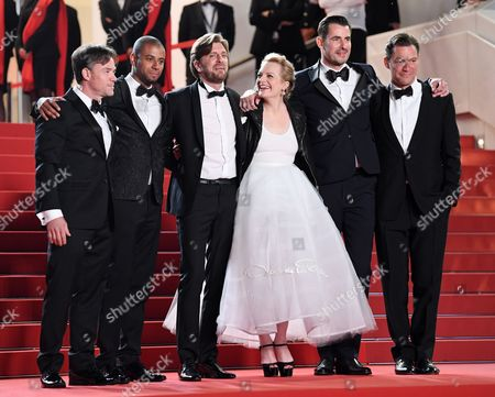 Stock Picture of Terry Notary, Christopher Laesso, Ruben Ostlund, Elisabeth Moss, Claes Bang and Dominic West