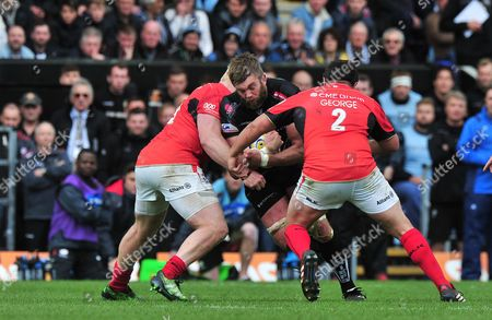 Geoff Parling of Exeter Chiefs is tackled by Jamie George of Saracens during the Aviva Premiership Semi Final Match between Exeter Chiefs and Saracens at Sandy Park, Exeter, Devon on May 20.