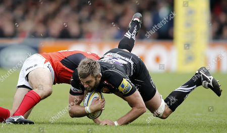Geoff Parling of Exeter Chiefs is tackled by Jackson Wray of Saracens during the Aviva Premiership semi final match between Exeter Chiefs and Saracens at Sandy Park on May 20th , Exeter, Devon.