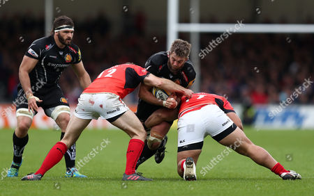 Geoff Parling of Exeter Chiefs is tackled by Duncan Taylor and Titi Lamositele of Saracens