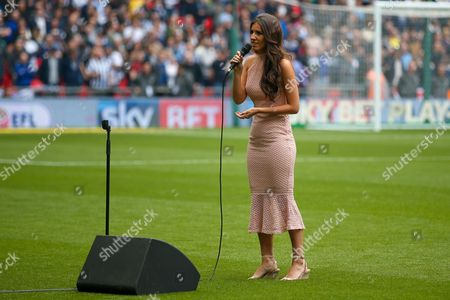 Faryl Smith sings the National Anthem during the EFL Sky Bet League 1 play off final match between Bradford City and Millwall at Wembley Stadium, London