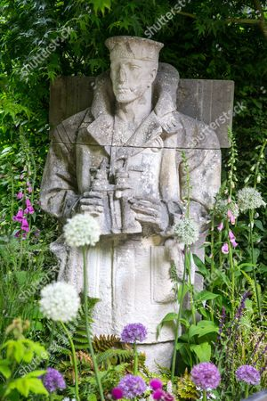 Detail of  a royal naval statue in the Commonwealth War Graves Commission Centenary Garden.The garden  celebrates 100 years since its foundation by Royal charter.It continues to care for 1.7 million war dead in more than 150 countries. The garden is designed by David Domoney