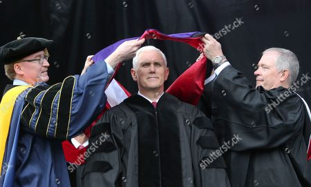 Michael Pence, Robert Graham, Paul McNulty Vice President Michael Pence receives a sash representing an honorary degree at the commencement ceremony at Grove City College, in Grove City, Pa. College Provost Robert Graham, left, college President Paul McNulty, place the sash