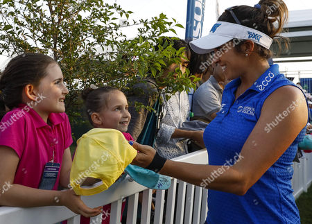Gerina Piller signs autographs for two little girls after the third round of the Kingsmill Championship on the Kingsmill Resort River Course in Williamsburg, Virginia