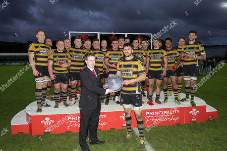 Adam Brown Newport captain is presented with the Tier 2 Trophy by Jamie Evans Customer Consultant at the Neath branch of the Principality Building Society