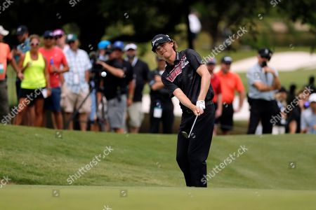 Stock Picture of Willy Wilcox chips onto the 11th green during the third round of the Byron Nelson golf tournament, in Irving, Texas