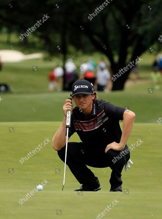 Willy Wilcox checks his line before putting on the 11th green during the third round of the Byron Nelson golf tournament, in Irving, Texas