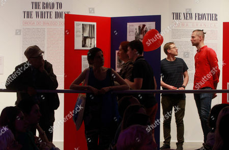 Visitors watch exhibition of Jack & Jackie devoted John F Kennedy in Warsaw, Poland, during the European museum night. During this annual event, the closing time of the participating museums are postponed until one in the morning, and the public gain entrance for free