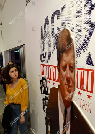 Visitors watch exhibition of Jackie & Jack, devoted to John F Kennedy in Warsaw, Poland, during the European museum night. During this annual event, the closing time of the participating museums are postponed until one in the morning, and the public gain entrance for free