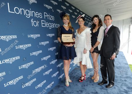 Stock Picture of Jennifer Winslow, Michelle Payne, Reed Kessler, Ramon Dominguez Australian jockey Michelle Payne, American show jumper Reed Kessler and Hall of Fame Award Winning Jockey Ramon Dominguez, left to right, present Jennifer Winslow, left, with a Longines DolceVita timepiece after she won the Longines Prize for Elegance at the Preakness Stakes, at Pimlico Race Course in Baltimore. Longines, the Swiss watch manufacturer known for its elegant timepieces, is the Official Watch and Timekeeper of the 142nd annual Preakness Stakes and the Triple Crown