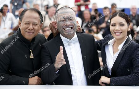 Actor Vithaya Pansringarm (L), Actor Panya Yimumphai and Actress Pornchanok Mabklang (R) pose during the photocall for 'A Prayer Before Dawn' at the 70th annual Cannes Film Festival, in Cannes, France, 19 May 2017. The movie is presented in the Midnight Screening section of the festival which runs from 17 to 28 May.