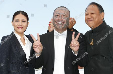 Actor Vithaya Pansringarm (R), Actor Panya Yimumphai and Actress Pornchanok Mabklang (L) pose during the photocall for 'A Prayer Before Dawn' at the 70th annual Cannes Film Festival, in Cannes, France, 19 May 2017. The movie is presented in the Midnight Screening section of the festival which runs from 17 to 28 May.