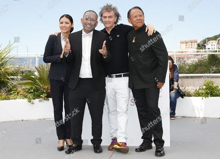 (L-R) Actress Pornchanok Mabklang, Actor Panya Yimumphai, French director Jean-Stéphane Sauvaire and Actor Vithaya Pansringarm pose during the photocall for 'A Prayer Before Dawn' at the 70th annual Cannes Film Festival, in Cannes, France, 19 May 2017. The movie is presented in the Midnight Screening section of the festival which runs from 17 to 28 May.