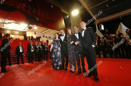 (L-R) Producer Viktoria Petranyi, Hungarian director Kornel Mundruczo, Screenwriter Kata Weber, Hungarian actor Zsombor Jeger and actor Merab Ninidze arrive for the premiere of 'Jupiter's Moon' during the 70th annual Cannes Film Festival, in Cannes, France, 19 May 2017. The movie is presented in the Official Competition of the festival which runs from 17 to 28 May.