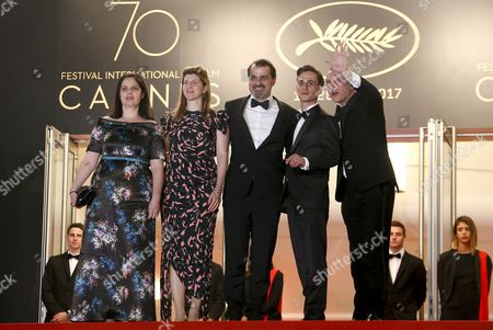 (R-L) Producer Viktoria Petranyi, Hungarian director Kornel Mundruczo, Screenwriter Kata Weber, Hungarian actor Zsombor Jeger and actor Merab Ninidze arrive for the premiere of 'Jupiter's Moon' during the 70th annual Cannes Film Festival, in Cannes, France, 19 May 2017. The movie is presented in the Official Competition of the festival which runs from 17 to 28 May.